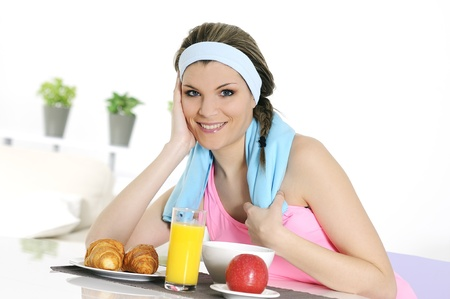 young athletic woman having breakfast Stock Photo - 8942915
