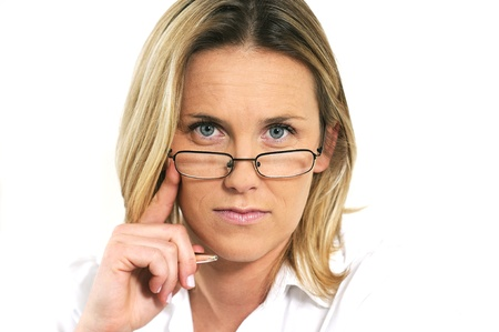 studious: studious and strict woman behind her glasses Stock Photo