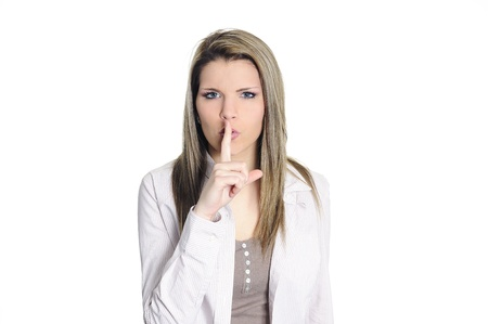 young woman seeking the silence with a finger on the mouth Stock Photo - 9096445