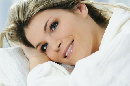 Beautiful woman is relaxing and dreaming photo