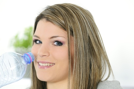 young beautiful woman with a bottle of water photo
