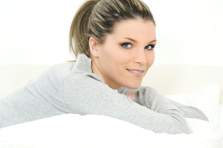 cocooning: Beautiful blond woman relaxing at home