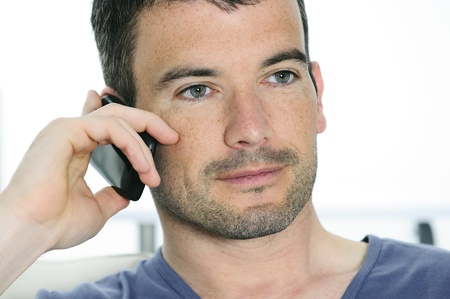 relaxed man with having a communication with a cellephone Stock Photo - 9530065