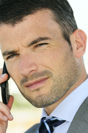 businessman is having a communication with his cellphone Stock Photo - 9530074