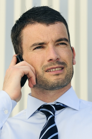 businessman is having a communication with his cellphone Stock Photo - 9530068