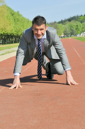 smartly: Portrait of a businessman on the starting blocks