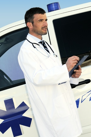 doctor is writing a report behind an ambulance Stock Photo - 9530108