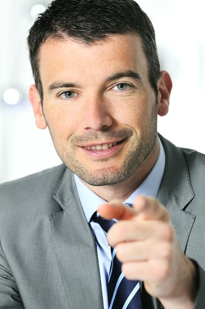 An attractive business man is helping you Stock Photo - 9530126