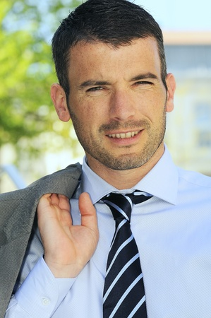 An attractive business man is walking outdoor Stock Photo - 9530123