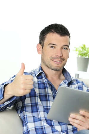 attractive relaxed and positive man is surfing on his  Stock Photo