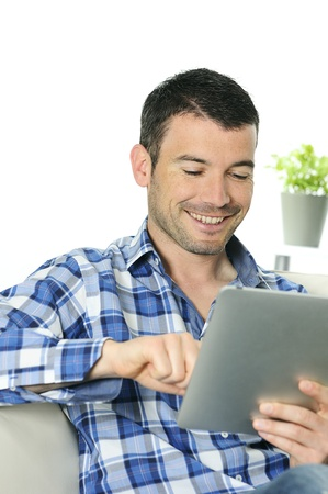 connexion: attractive relaxed and positive man is surfing on his tablet Stock Photo