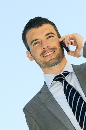 businessman is having a communication with his cellphone photo