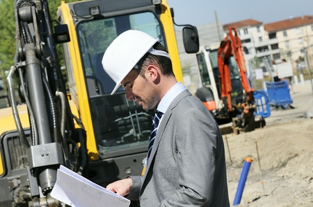 man wearing a helmet, manager, architect photo