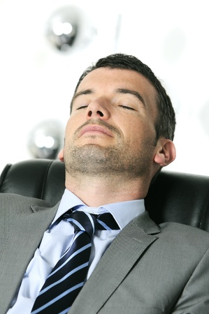 Attractive businessman is sleeping a while  from business Stock Photo - 9616445