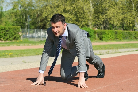 Portrait of a businessman on the starting blocks photo