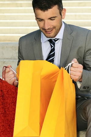 capitalist: great businessman outdoor with colored shopping bags