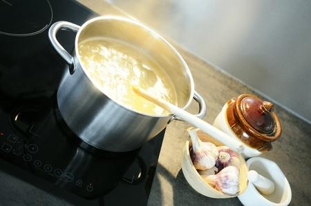 development of a recipe in a saucepan on the fire photo