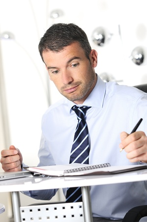 considerable: busy man hiding behind a stack of files