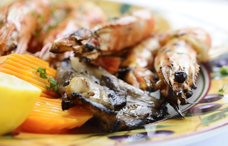 carots: photo of grilled king prawns with lemon and carots