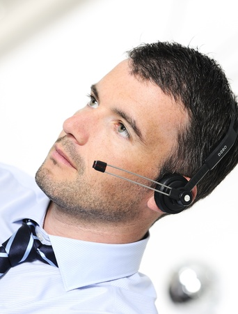 beautiful man is calling by headphone photo