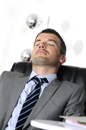 Attractive businessman is sleeping a while  from business Stock Photo - 10691254