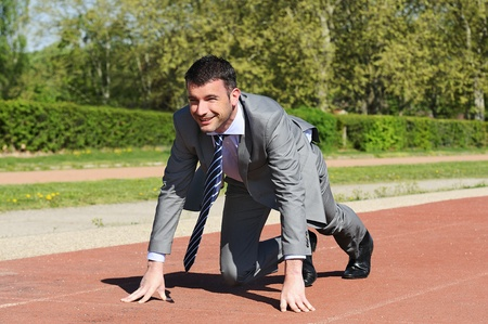 Portrait of a businessman on the starting blocks