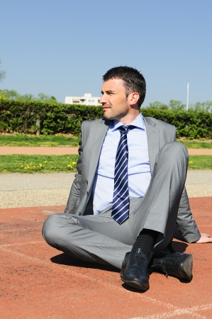situation: businessman sitting is thinking to the future, down outdoor situation