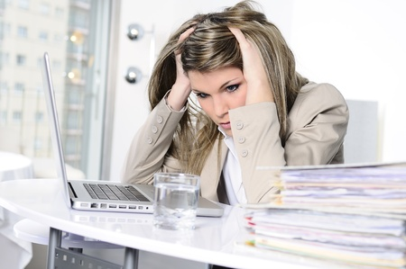 stressed woman working on computer
