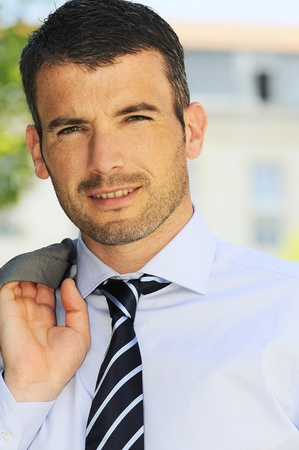 An attractive business man is walking outdoor photo