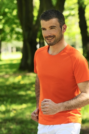 sportive and cheerful man in a natural background photo
