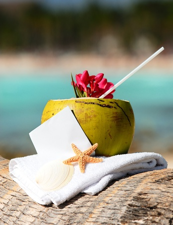 tropical drink: Coconut cocktail starfish tropical Caribbean beach refreshment and towel