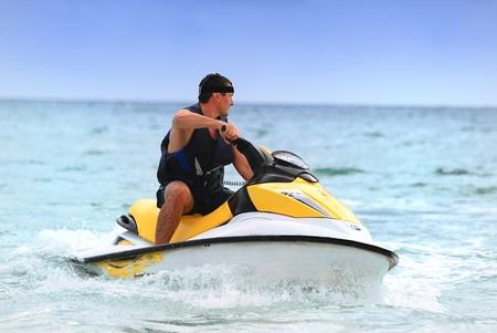 jetski: Man on Wave Runner turns fast on the water