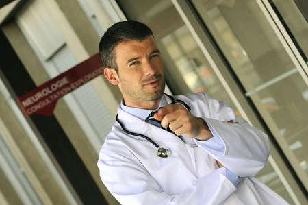 portrait of doctor in front an entrance of the hospital Stock Photo - 12114216