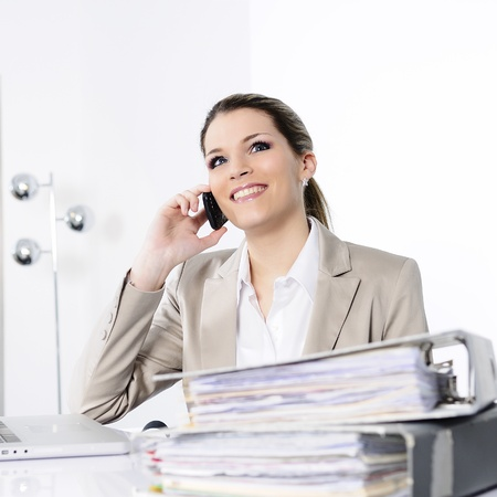 phonecall: Closeup of businesswoman in the office talking on the phone
