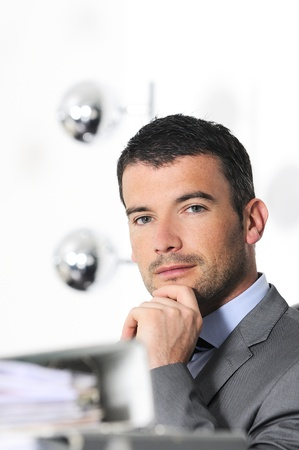 An attractive business man in a light business environment Stock Photo - 12322198