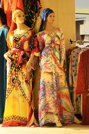 Mannequins in clothes shop with oriental and colored dresses