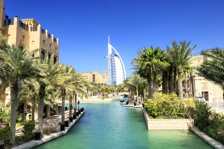 View at hotel Burj al Arab from Madinat Jumeirah in Dubai Madinat Jumeirah encompasses two hotels and clusters of 29 traditional Arabic houses United Arabe Emirates