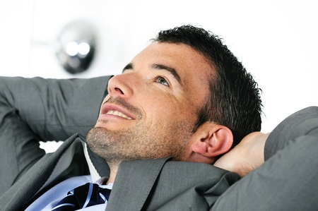 Attractive businessman is taking break from business photo