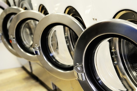 A row of industrial washing machines in a public laundromat Stock Photo - 13484756