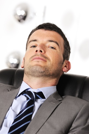 Attractive businessman is sleeping a while  from business Stock Photo - 13484703