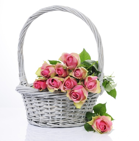 bouquet of pink roses in basket isolated on white background  photo