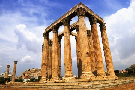 zeus: Temple of the Olympian Zeus and the Acropolis in Athens, Greece  Stock Photo