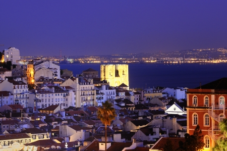 Historic mediterranean architecture with church at night with light in Lisboa, Portugal photo