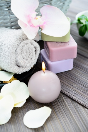 Spa and wellness setting with natural soap, candles and towel. Beige dayspa photo