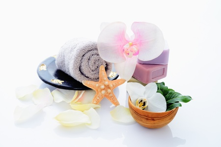 Spa and wellness setting with natural soap, starfish and towel. Beige dayspa photo