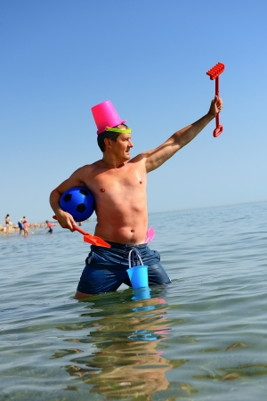 madman is playing the role of a warrior with beach toys Stock Photo - 14901227