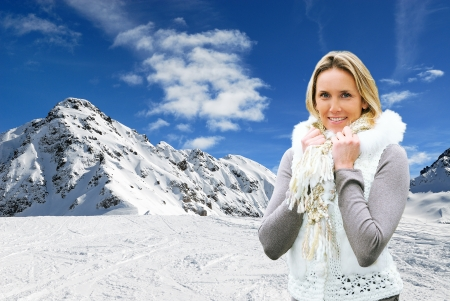 attractive woman in the middle of the mountains in winter Stock Photo