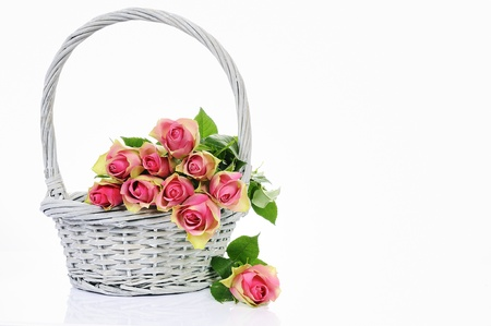 bunch up: bouquet of pink roses in basket isolated on white background