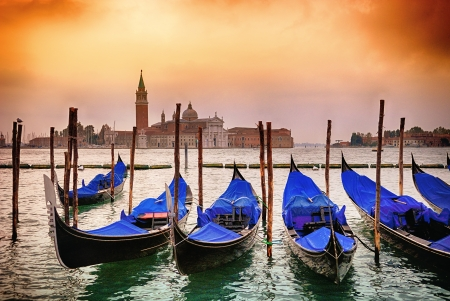 saint marco: Gondolas moored by Saint Mark square with San Giorgio di Maggiore church in the background - Venice, Venezia, Italy, Europe