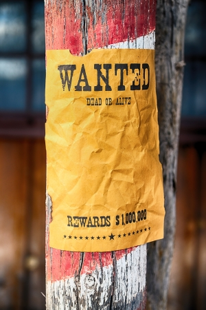 drawingpin: vintage wanted poster in a gost town Stock Photo